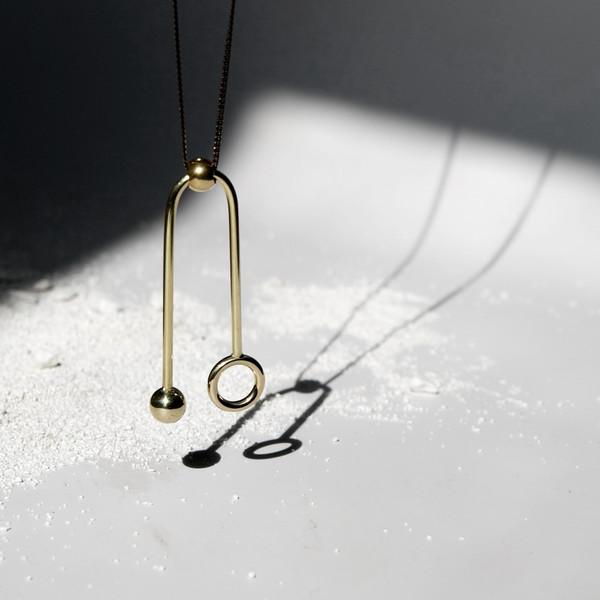 7115 by Szeki Sphere + Ring U-Sign Necklace J16