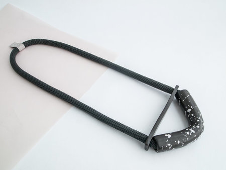 YYY speckled black bent half moon necklace