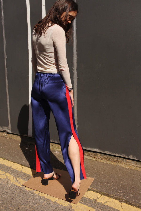 ARIES ARISE Open Hem Silk Track Pants - Navy/red contrast panel