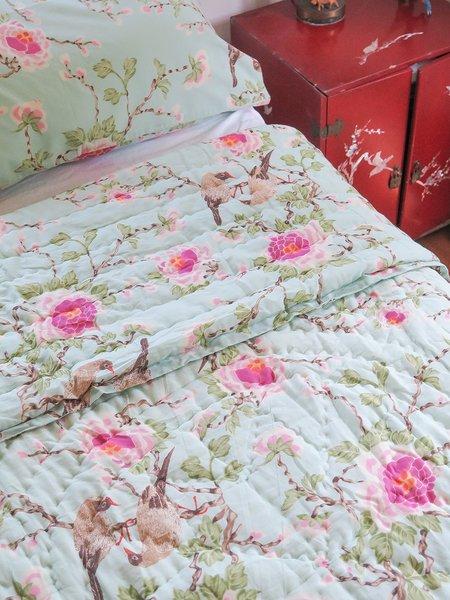 Erica Tanov lovebird quilt - aqua