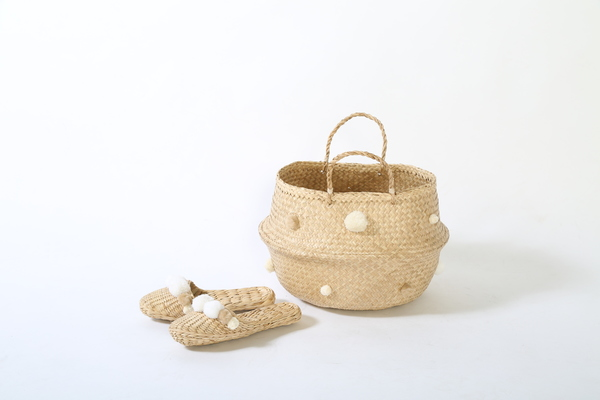 white and cream collabsable beach basket, home storage