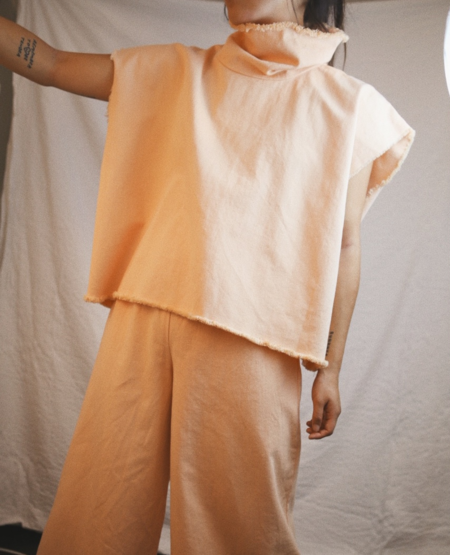 ASHLEY ROWE Sleeveless Turtleneck - Peach Nougat