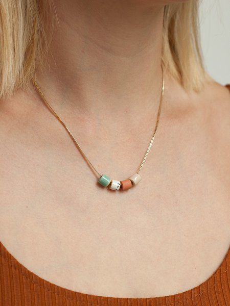 The Pursuits of Happiness Tiny Bead Necklace