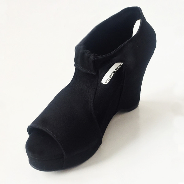 Slow and Steady Wins the Race Wedge Sandal in Black