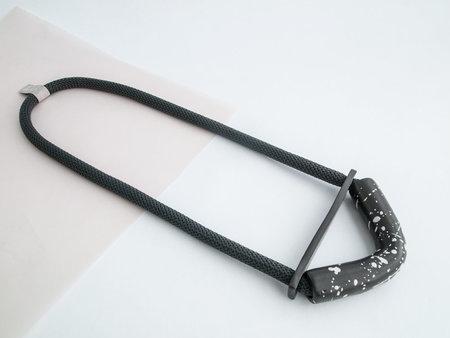 YYY speckled black bent half moon necklace