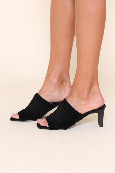 """INTENTIONALLY __________."" Trix Shoe"