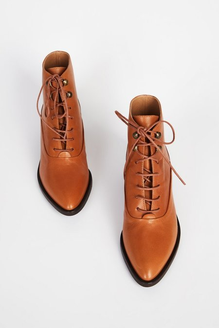 INTENTIONALLY __________ WEST Whiskey bootie