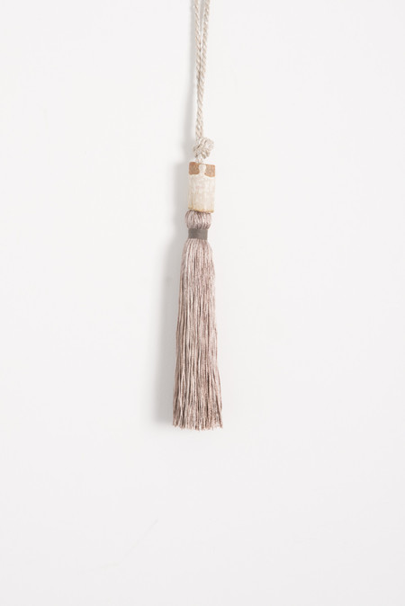 All Roads Tassel with Ceramic Bead and Metallic Rope in Silver